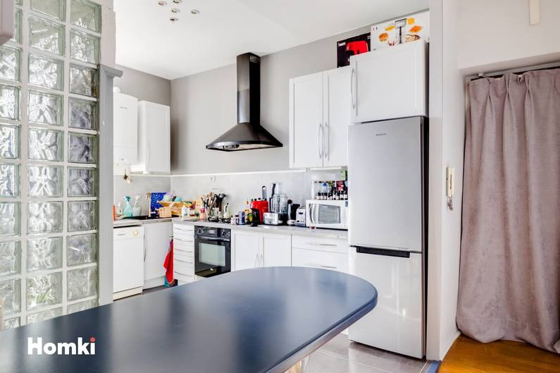 Homki - Vente Appartement  de 61.0 m² à Lyon 69008