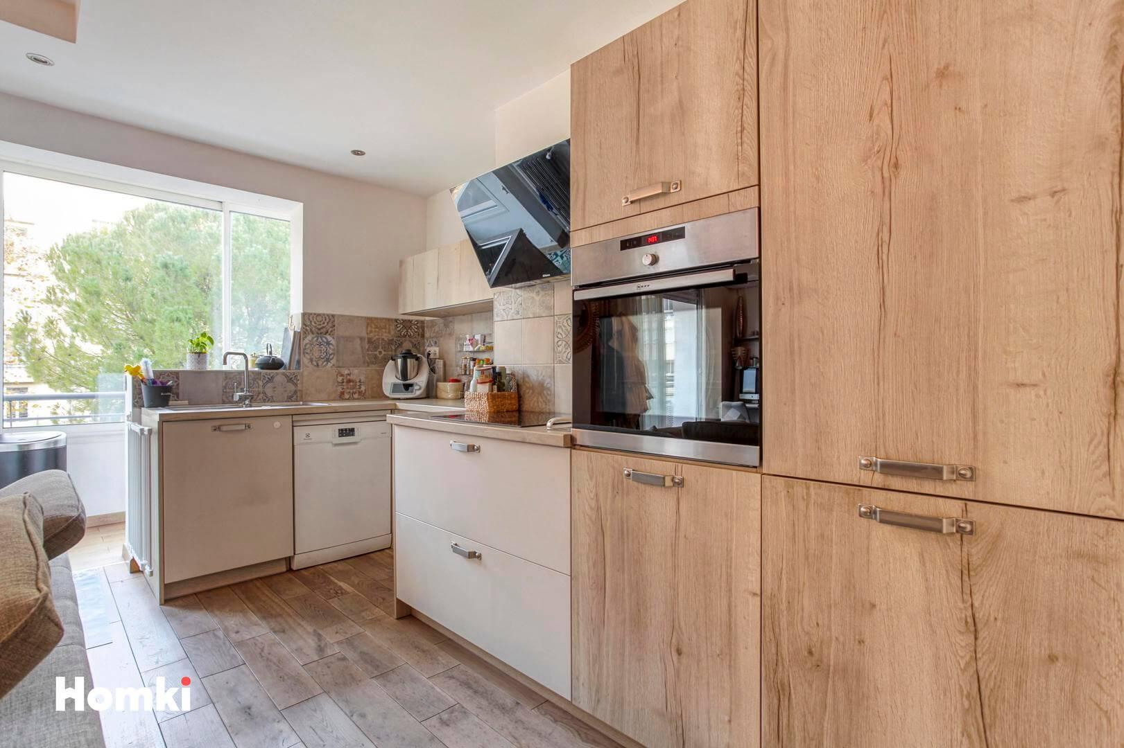 Homki - Vente Appartement  de 77.0 m² à Marseille 13008