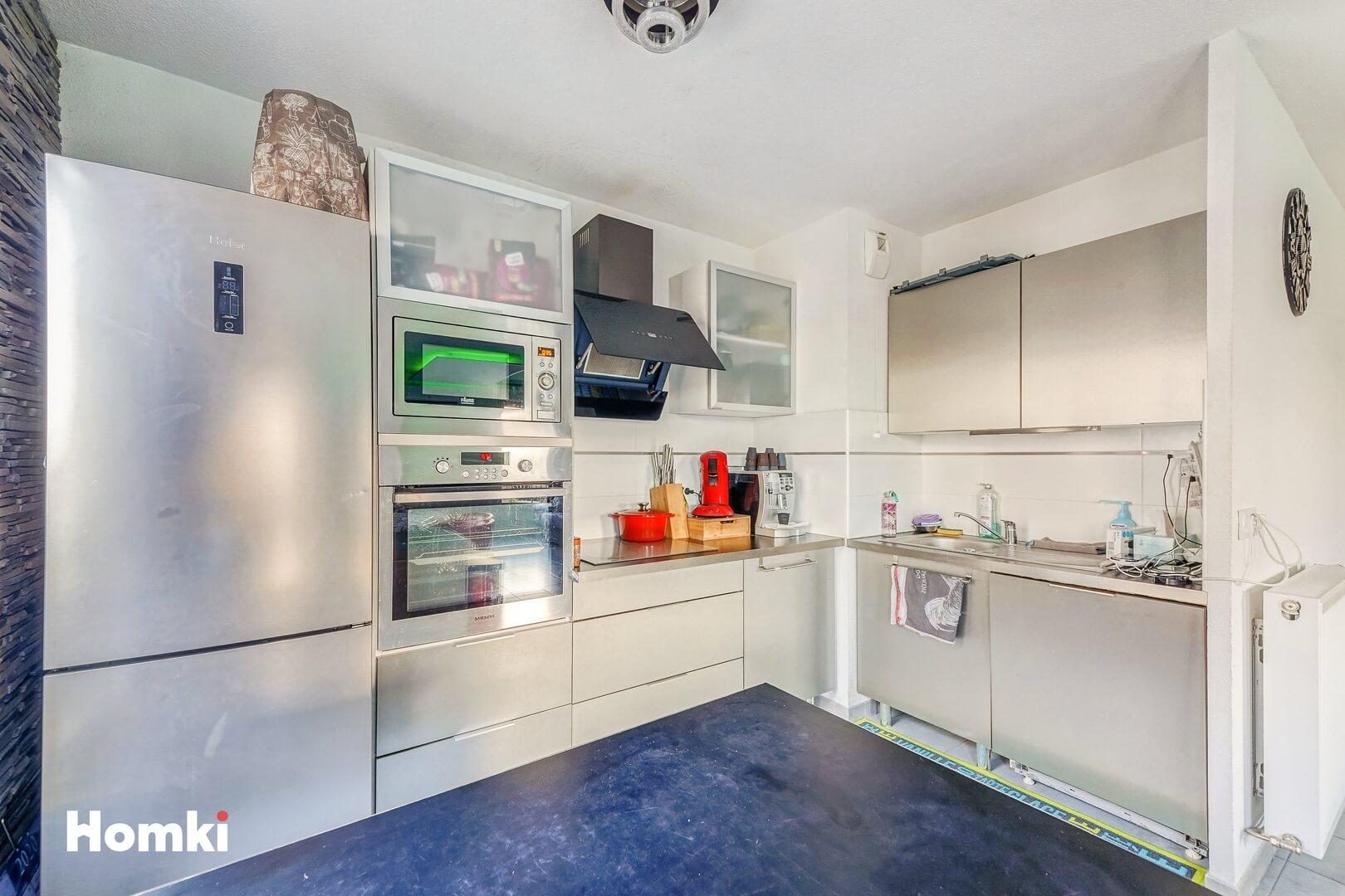 Homki - Vente Appartement  de 65.0 m² à Marseille 13013
