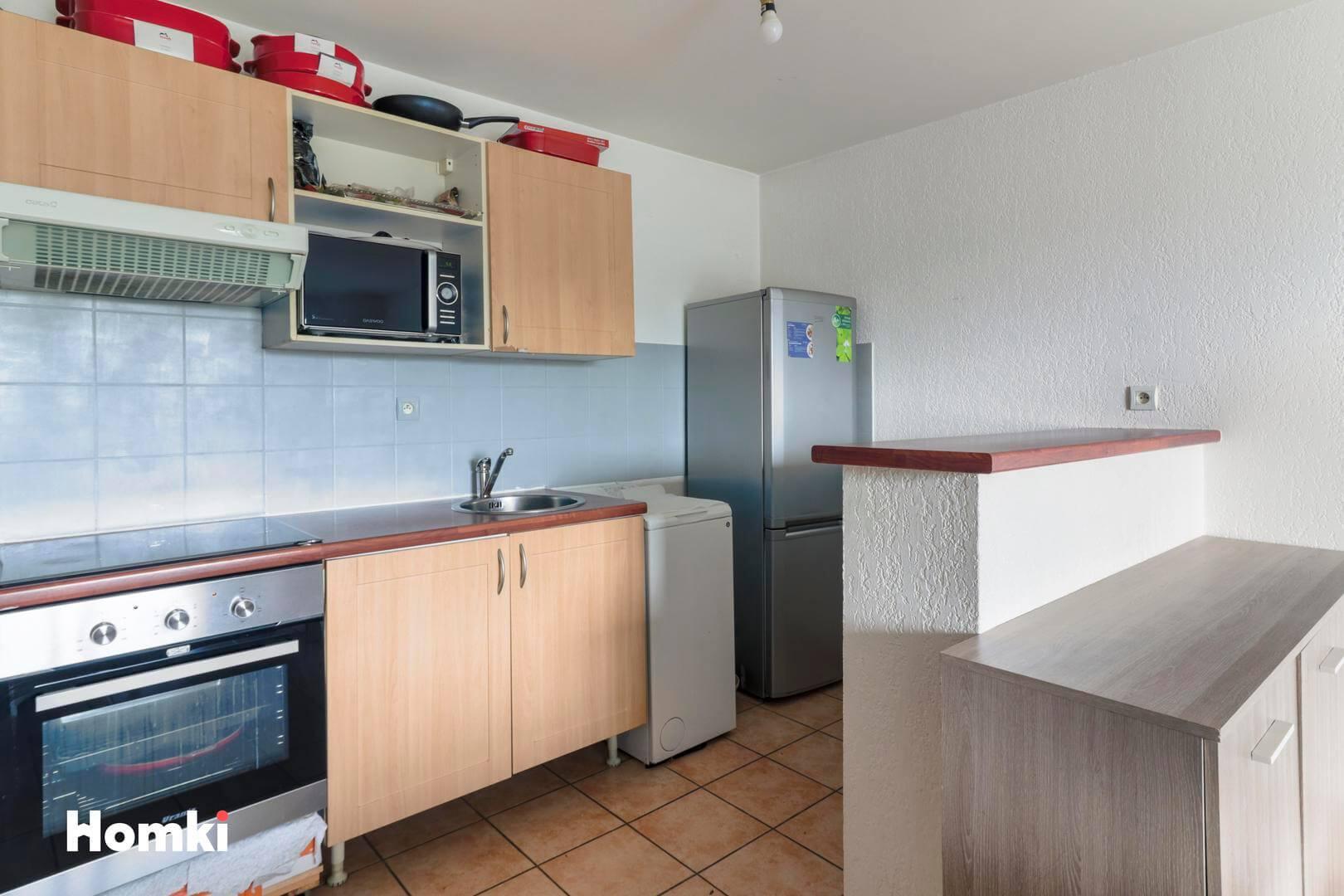 Homki - Vente Appartement  de 54.0 m² à Toulouse 31300