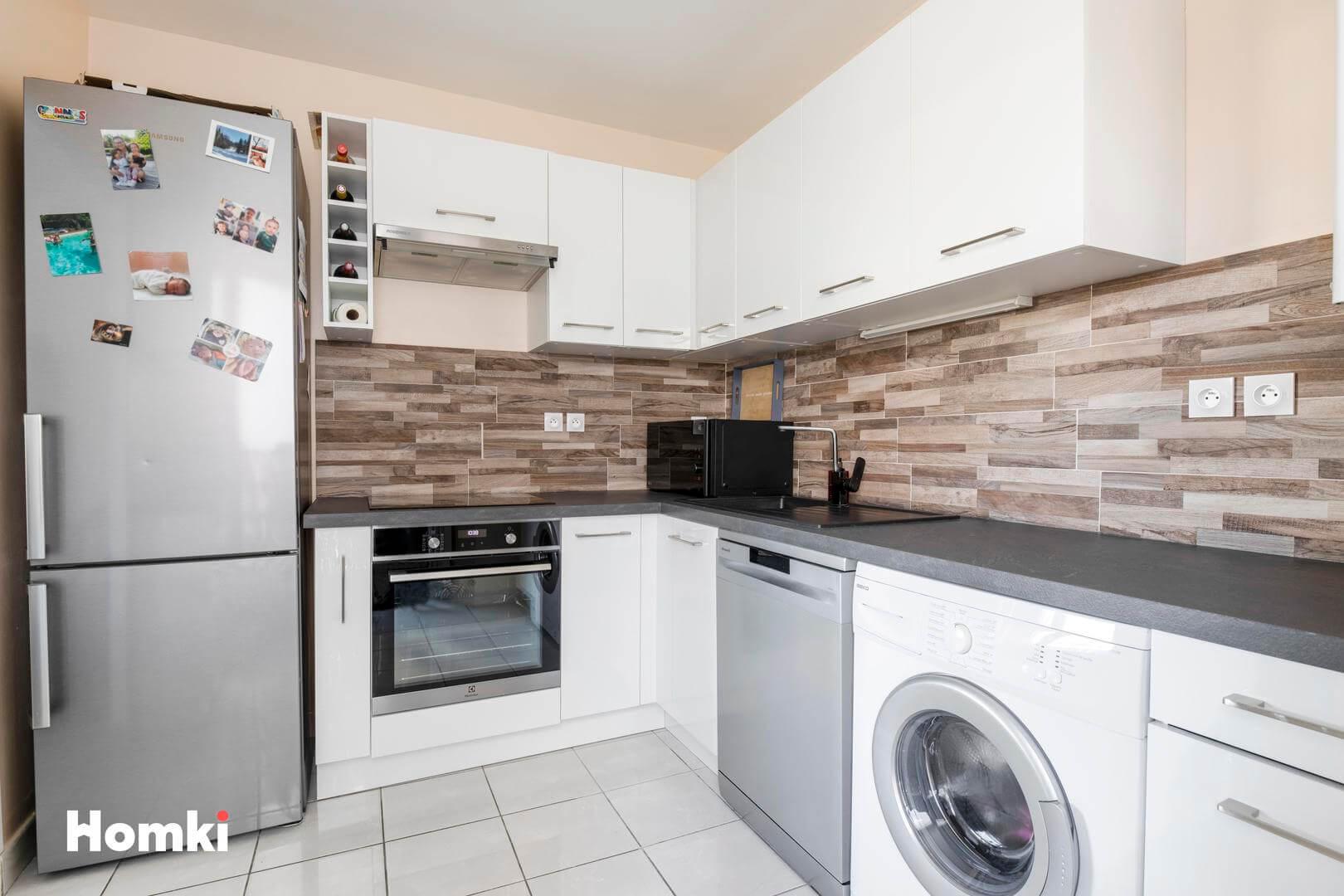 Homki - Vente Appartement  de 59.0 m² à Lyon 69008