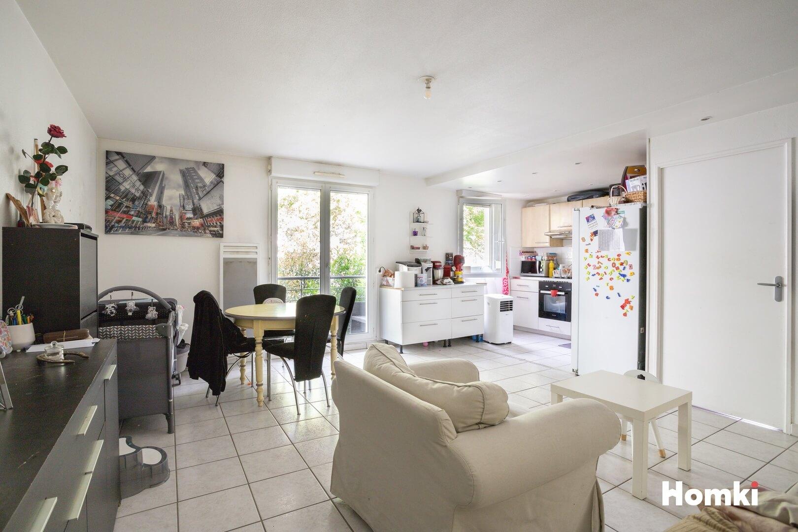 Homki - Vente Appartement  de 63.0 m² à Vénissieux 69200