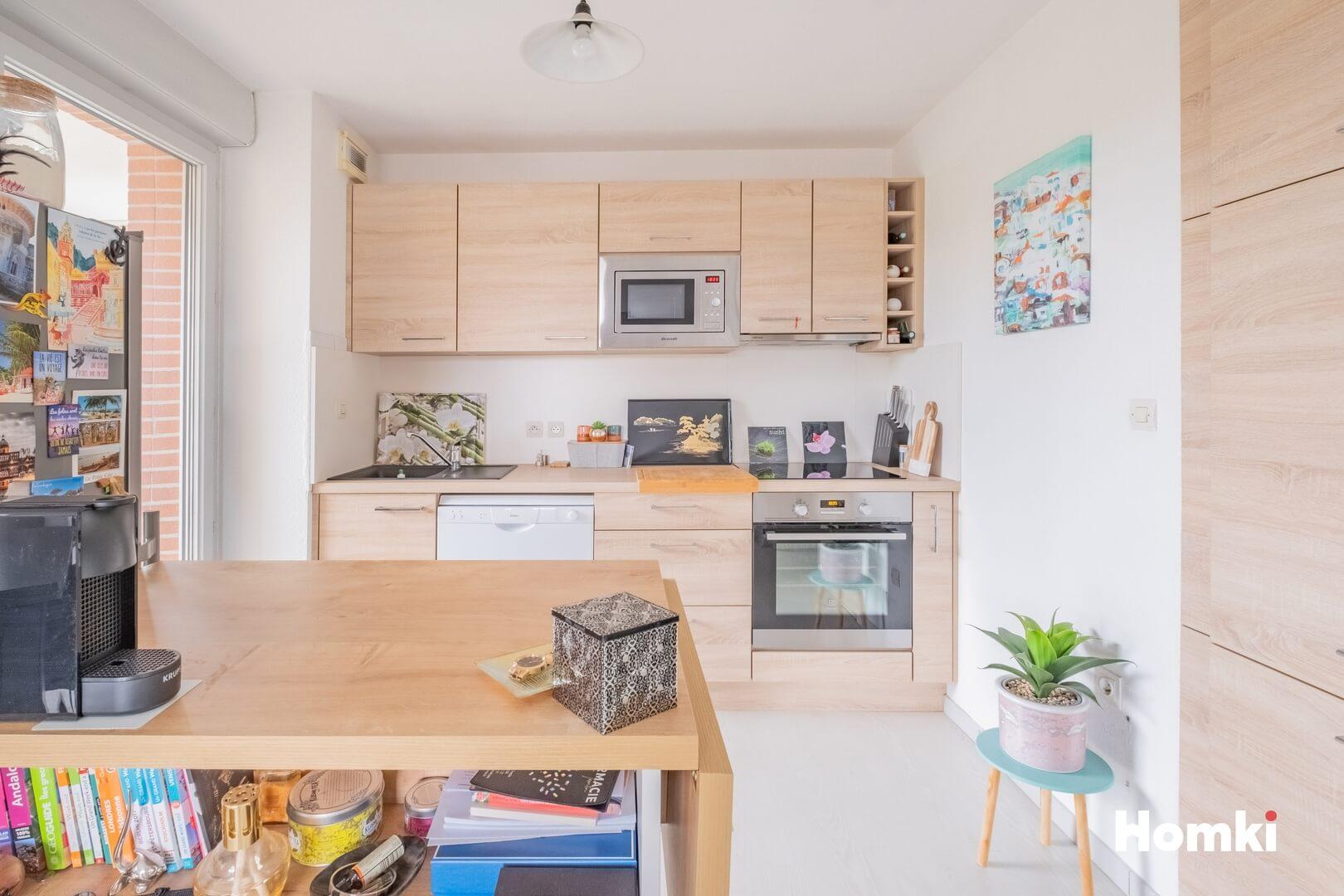 Homki - Vente Appartement  de 61.0 m² à Toulouse 31200