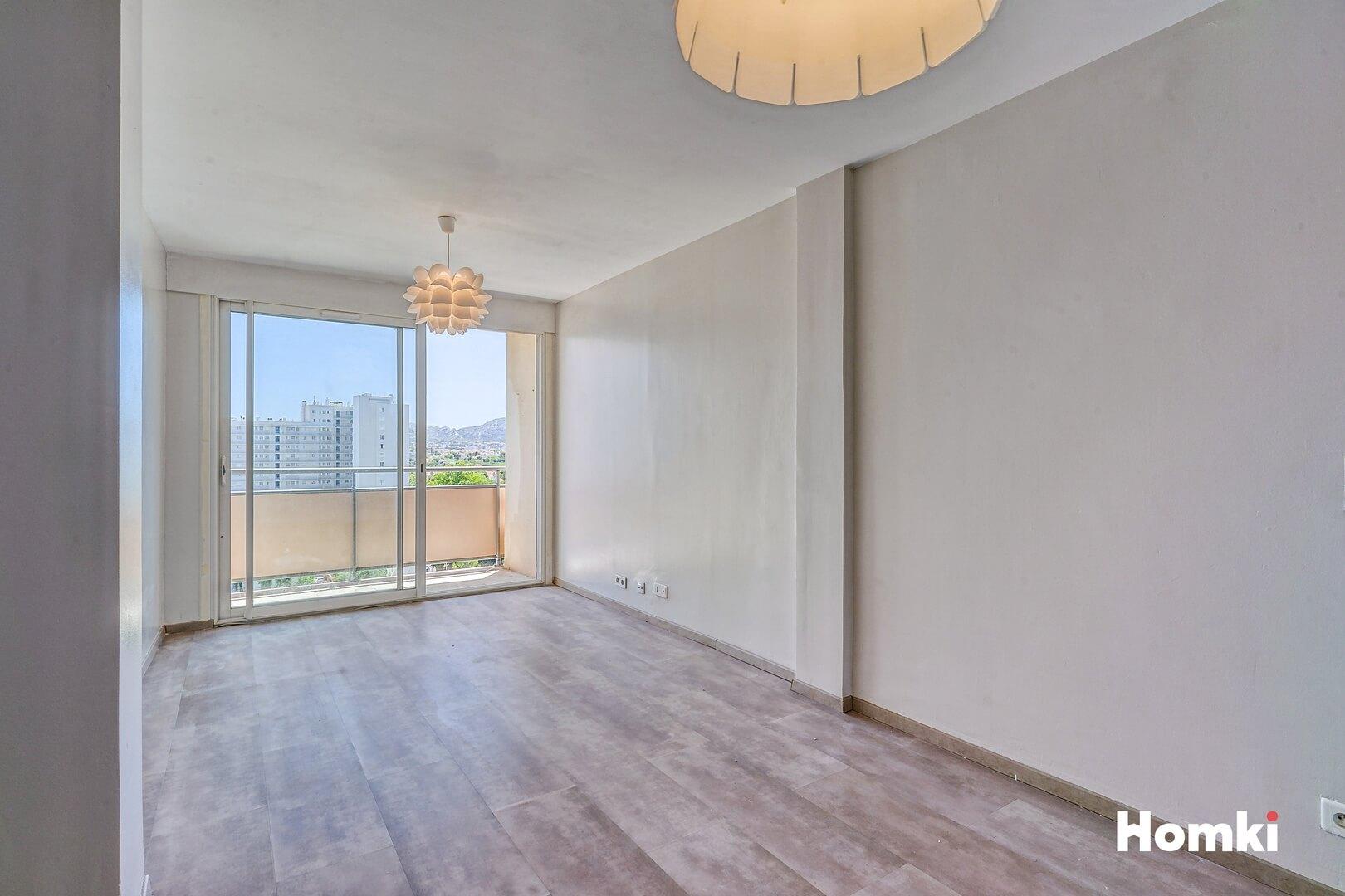 Homki - Vente Appartement  de 70.0 m² à Marseille 13009
