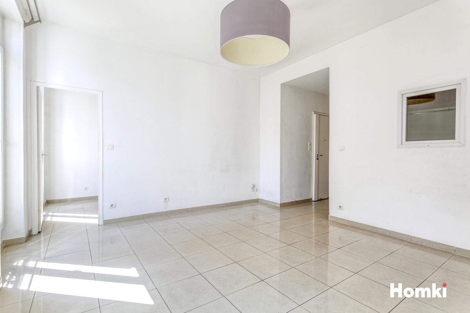 Homki - Vente Appartement  de 64.0 m² à Marseille 13006