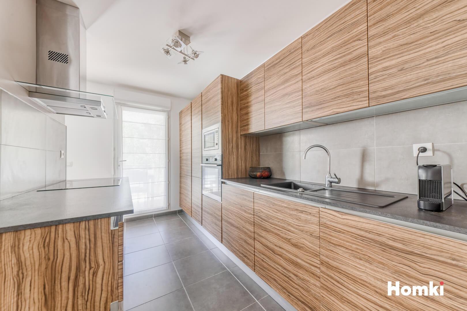 Homki - Vente Appartement  de 82.0 m² à Marseille 13013