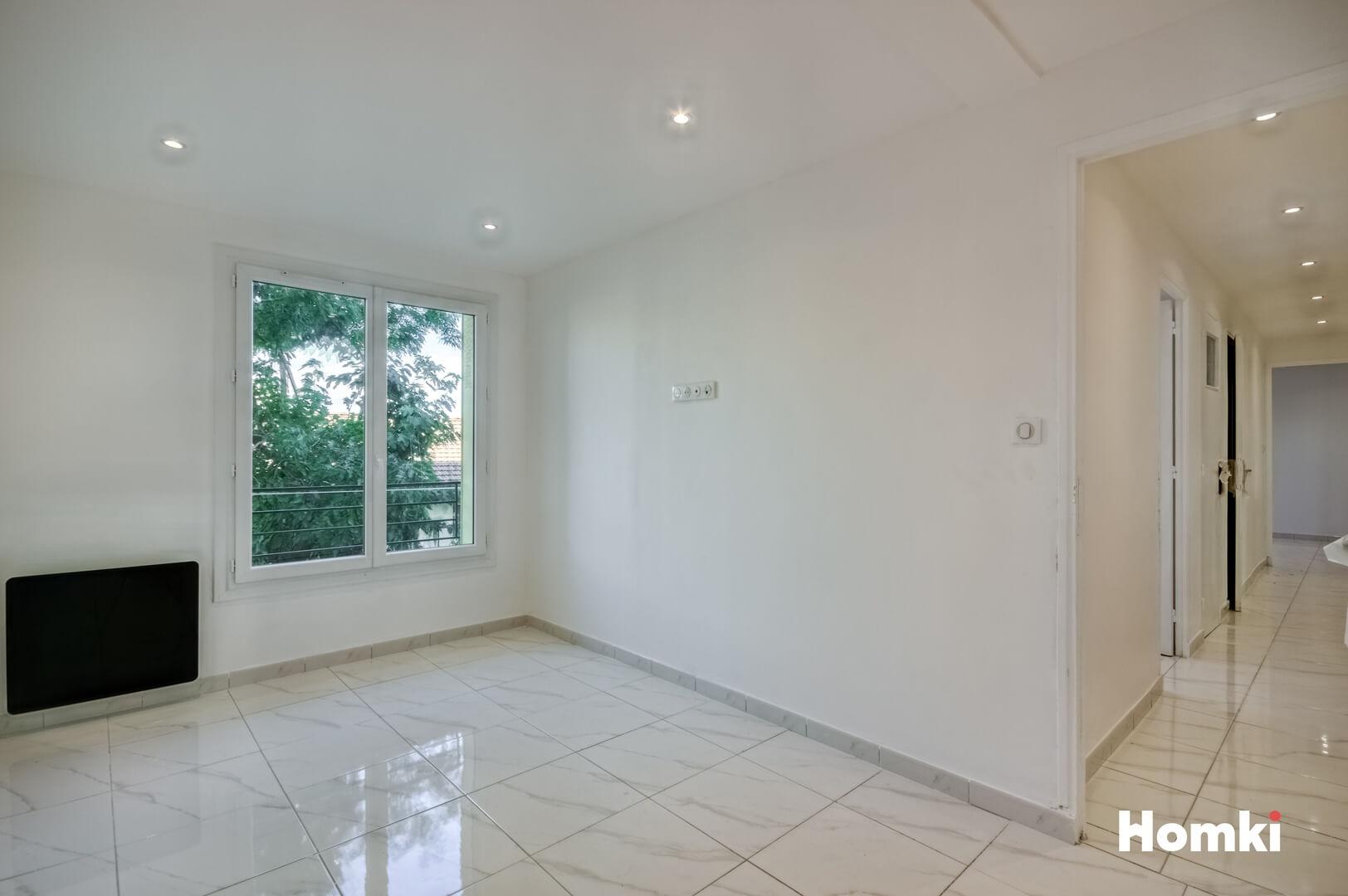 Homki - Vente Appartement  de 56.0 m² à Marseille 13004